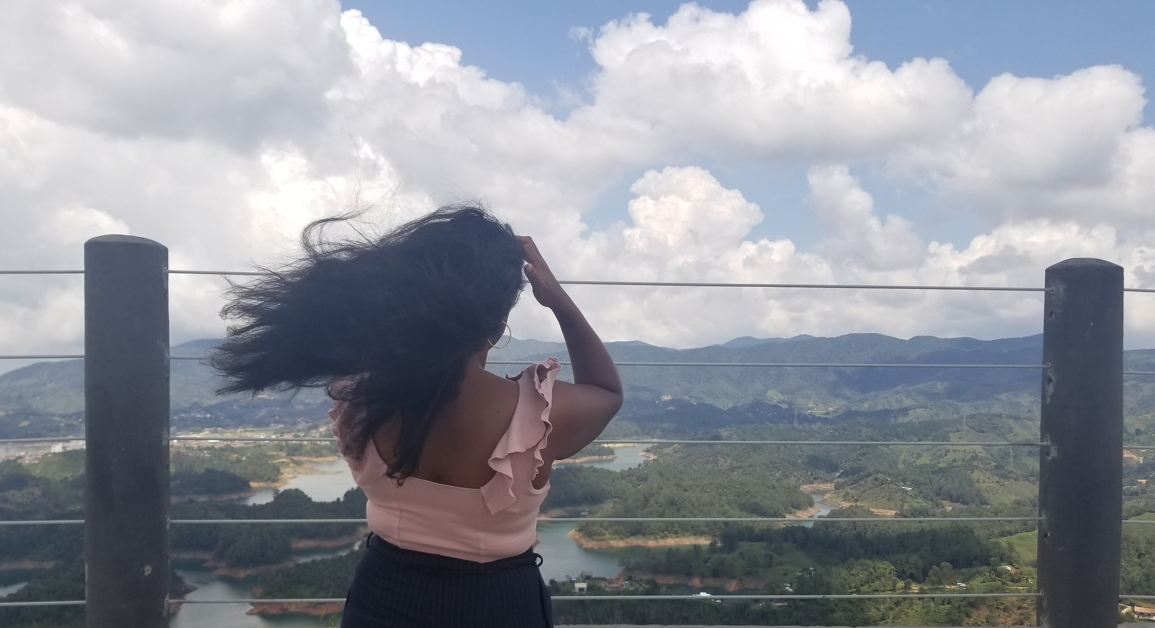 Enjoying the view from the top of El Penol, also known as La Piedra, in Guatape, Colombia.